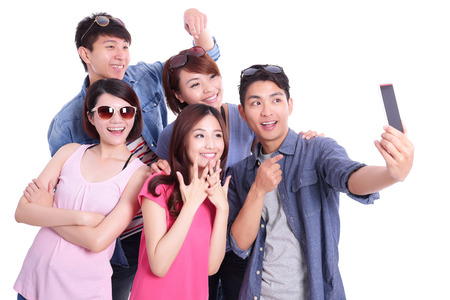 asian group: Happy teenagers taking pictures by themselves isolated on white background, asian