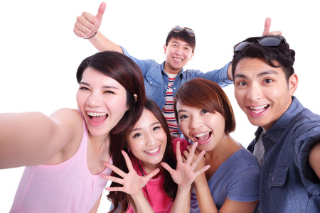asia people: Happy teenagers taking pictures by themselves isolated on white background, asian