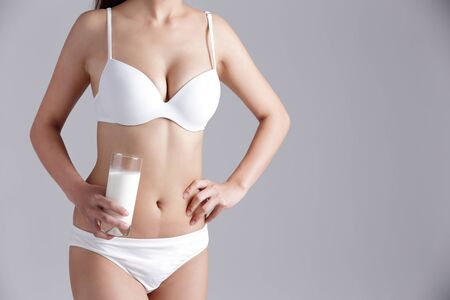 woman underwear: Milk and Health woman body - Woman smile with milk for Healthy lifestyles concept with gray background, asian beauty