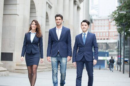 business people walk on the road in hong kong Stock Photo
