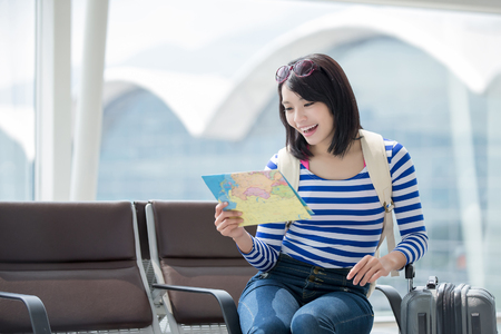 see: beauty woman take map and smile happily