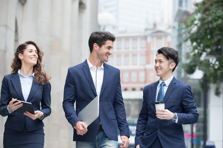 walk in: business people take notebook and coffee walk on the road in hong kong Stock Photo