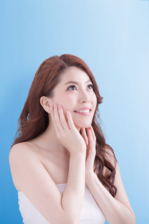 lean: beauty woman smile and look copy space happily with isolated blue background, asian