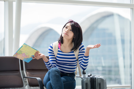 eye traveller: beauty woman take map and confuse Stock Photo