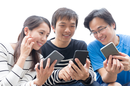 people smile and take smart phone together, asian