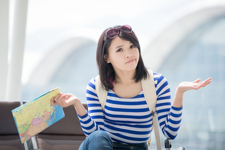 beauty woman take map and confuse Stock Photo