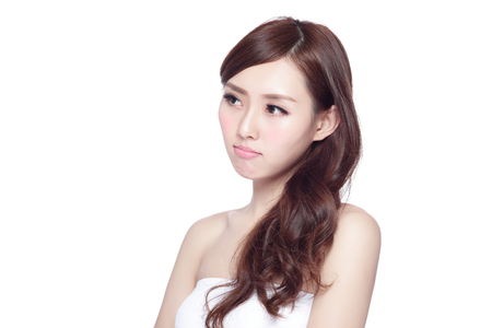 Face Skin Problem - young woman unhappy with her skin isolated, concept for skin care, asian Stock Photo