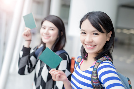 Happy group travel women hold passport and take a selfie. shot in hong kong, asian Zdjęcie Seryjne