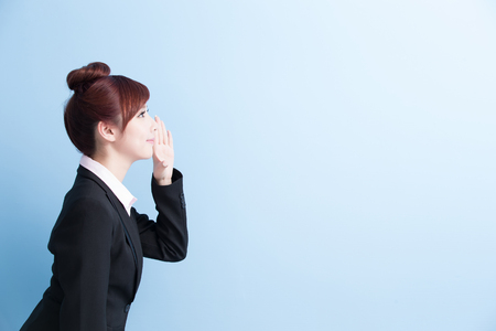 yell: business woman is yell with isolated on blue background, asian