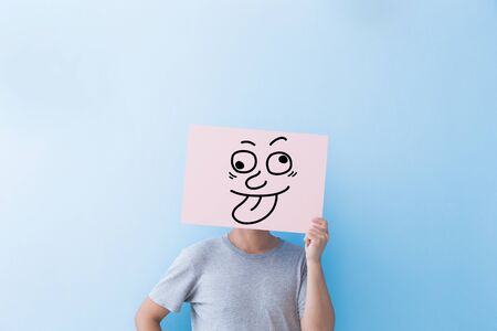 man holding a funny expression billboard isolated on blue background