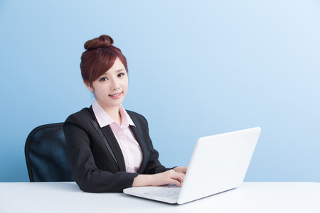 business woman use computer with isolated on blue background