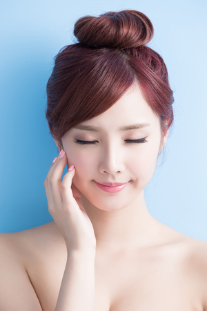 beauty  skin care woman relax closed eye isolated on bluebackground, asian Stock Photo