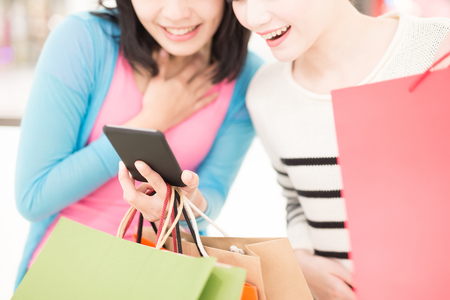 Happy woman shopping, selfie and use smart phone in the mall, shot in hong kong, asian