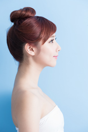 asian lady: beauty woman look somewhere isolated on bluebackground, asian