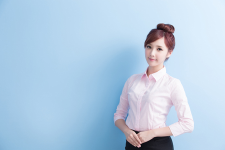 business woman is smile to you with isolated on blue background, asian Фото со стока