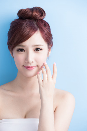 beauty skin: beauty woman smile to you isolated on bluebackground, asian