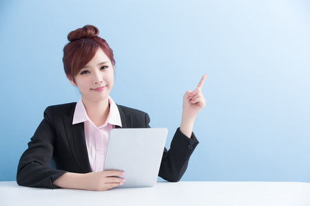 business woman use tablet and show something with isolated on blue background