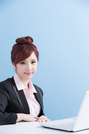 use computer: business woman use computer with isolated on blue background