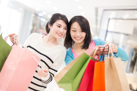 pushcart: Happy woman shopping in the mall, shot in hong kong, asian