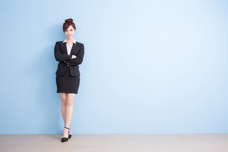 business woman is smile to you with blue background, asian
