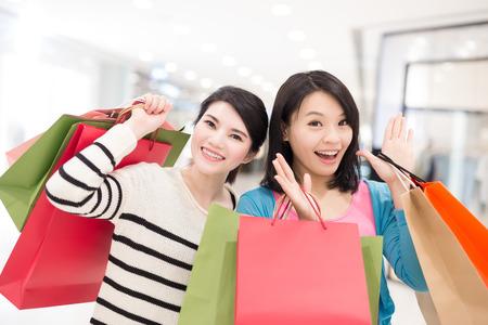 Happy woman shopping in the mall, shot in hong kong, asian