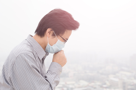 carbon emission: man wear masks with air pollution, asian Stock Photo