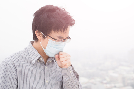 man wear masks with air pollution, asian Stock Photo