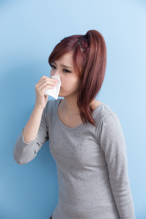 asia women: woman have a sick and painful isolated on blue background, asian Stock Photo