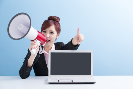 woman shouting: business woman take microphone shouting happily and show computer to you with isolated on blue background, asian