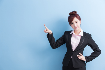 cross arms: business woman is smile and show something to you with isolated on blue background, asian