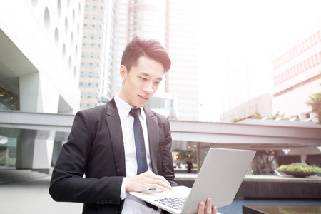 use computer: businessman use computer in honkong, asian Stock Photo