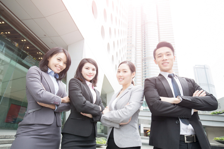 Business people team in the office, shot in Hong Kong, asian woman and man
