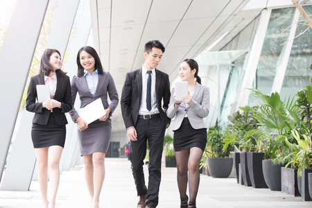 asia women: businesspeople talk  in office in hongkong Stock Photo