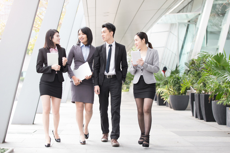 businesspeople talk in office in hongkong Stock Photo
