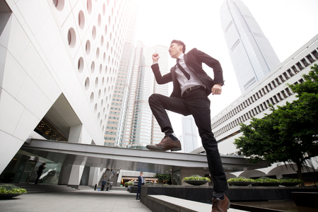 happy asian people: businessman is running in honkong, asian Stock Photo
