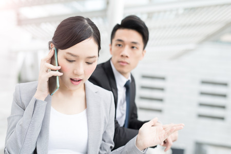 asian businesswoman: businesswoman talk on phone in office in hongkong Stock Photo