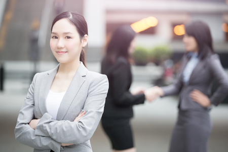 businesswoman smile happily to you in hongkong