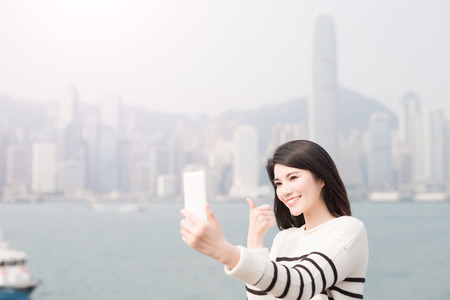 thumbup: beauty woman selfie and thumb up in hongkong Stock Photo
