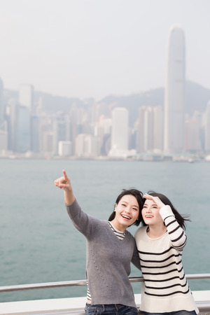 asia women: two beauty show something in hongkong Stock Photo