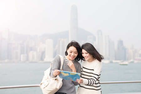two visions: two beauty woman look map in hongkong