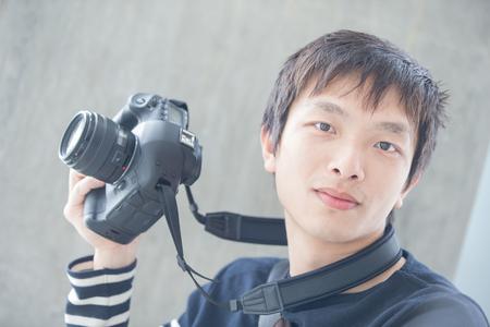 hongkong: man take camera and look to you in hongkong