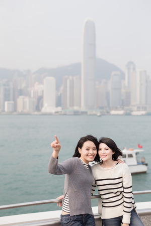 asian group: two beauty show something in hongkong Stock Photo