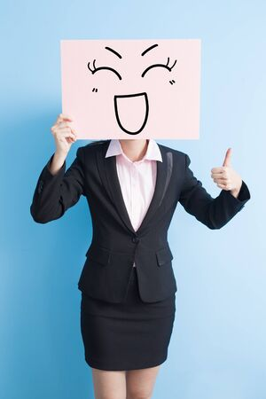billboard background: business woman take happy billboard and thumb up, isolated blue background Stock Photo