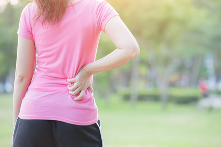 waistline: sport woman waist injury in the park,great for your design