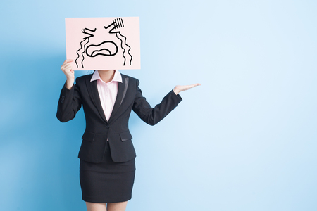 billboard background: business woman take cry billboard and show something, isolated blue background