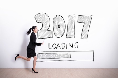 new year is loading now successful business woman running and hold laptop computer with