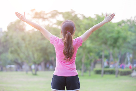 sport woman feel free in the park,great for your design Stock Photo