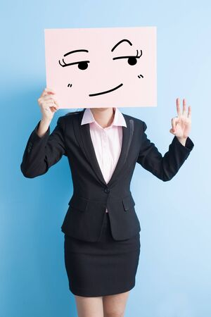 business woman take look somewhere billboard and show ok to you, isolated blue background Stock Photo