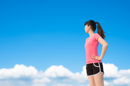 sport woman look somewhere with sky background Stock Photo