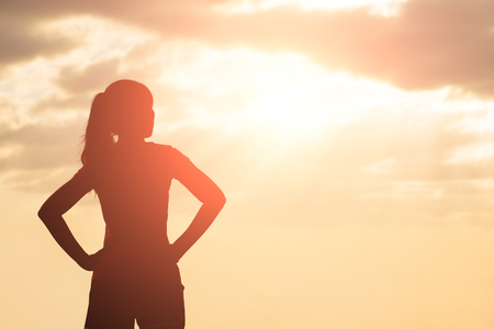 silhouette of woman look and think with sunlight